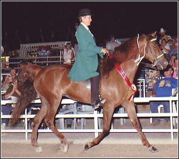 Lad's Red Rebecca Z. & Laura Atkinson on their victory lap at the Show & Celebration